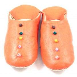 Pom-pom slippers in orange leather