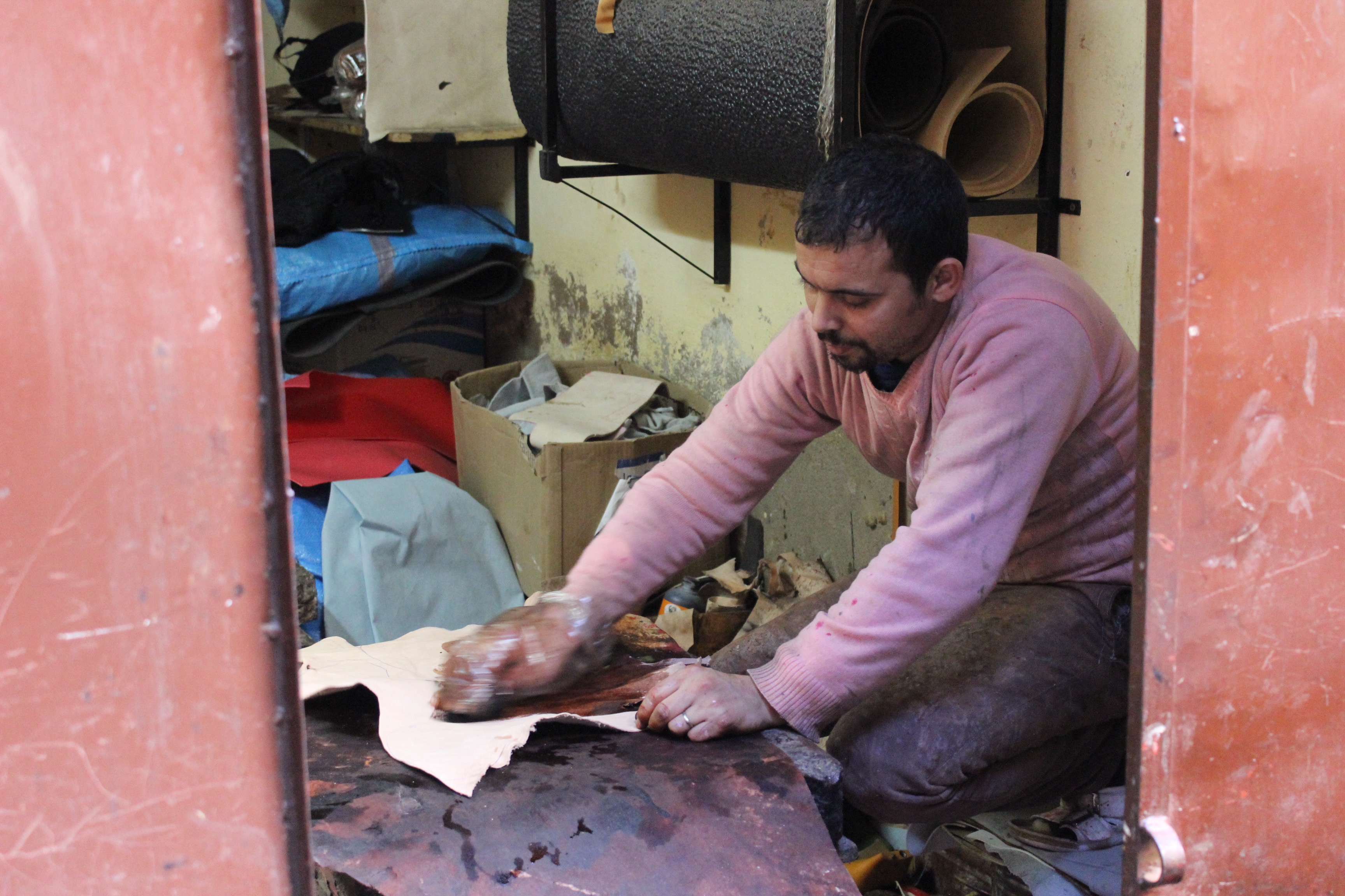 Artisan babouchier of Marrakech preparing the leather for the manufacture of Moroccan babouches